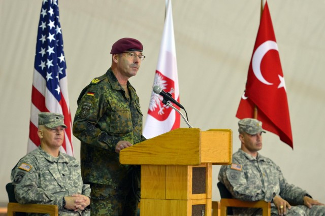 German Army Maj. Gen. Volker Halbauer, the commander of the NATO-led Kosovo Forces, addresses the audience at the Joint Readiness Detachment-East transfer of authority ceremony at Camp Bondsteel, Kosovo, May 26. JRD-East works alongside several NATO nations to serve as a link between the KOR mission and civilian leaders in Kosovo. (U.S. Army photo by Staff Sgt. Cody Harding, 4th Public Affairs Detachment)