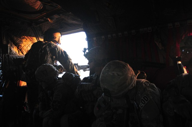 "Soldiers of Company C ""Chaos"", 1st Battalion, 38th Infantry Regiment, Combined Task Force 4-2 and Weapons Company, 6th Kandak, 205th Afghan National Army ride inside a CH-47 Chinook helicopter before air assaulting near the Kheybari Ghar ridgeline in the Panjwa'i District of Afghanistan as part of ""Operation Rising Sun III"" May 2.  The joint team traversed more than 32 kilometers of terrain while searching 82 Kuchi camps and 12 structures of interest. (U.S. Army photo by Sgt. Kimberly Hackbarth, 4th SBCT, 2nd Inf. Div. Public Affairs Office)"