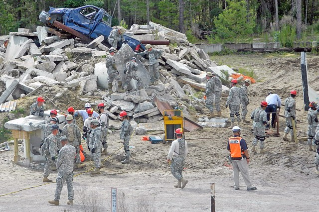 Soldiers with the 44th Civil Support Team, the 316th Engineer Company and the 766th Engineer Company, train on extracting simulated casualties from a debris pile at Camp Blanding, Fla., as part of Ardent Sentry 2013.
