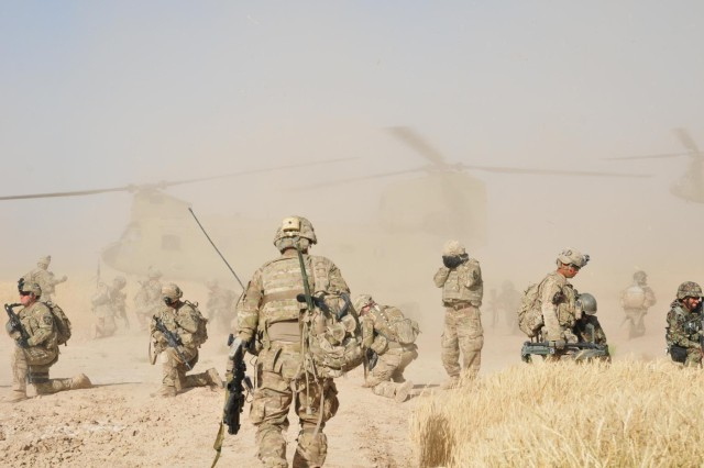 """Soldiers of Company C """"Chaos"""", 1st Battalion, 38th Infantry Regiment, Combined Task Force 4-2 and Weapons Company, 6th Kandak, 205th Afghan National Army prepare to load onto a CH-47 Chinook helicopter May 4 near the Kheybari Ghar ridgeline in the Panjwa'i District of Afghanistan as part of """"Operation Rising Sun III.""""  The joint team traversed more than 32 kilometers of terrain while searching 82 Kuchi camps and 12 structures of interest. (U.S. Army photo by Sgt. Kimberly Hackbarth, 4th SBCT, 2nd Inf. Div. Public Affairs Office)"""
