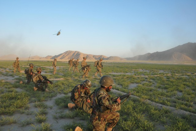 "Soldiers of Company C ""Chaos"", 1st Battalion, 38th Infantry Regiment, Combined Task Force 4-2 and Weapons Company, 6th Kandak, 205th Afghan National Army provide perimeter security after exiting a CH-47 Chinook helicopter near the Kheybari Ghar ridgeline in the Panjwa'i District of Afghanistan as part of ""Operation Rising Sun III"" May 4.  The joint team traversed more than 32 kilometers of terrain while searching 82 Kuchi camps and 12 structures of interest. (U.S. Army photo by Sgt. Kimberly Hackbarth, 4th SBCT, 2nd Inf. Div. Public Affairs Office)"