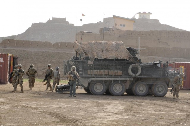 Members of the Combined Task Force 2-23 (2nd Battalion, 23rd Infantry Regiment), and Task Force 435 law enforcement, dismount a Stryker armored vehicle after arriving for the Tactical Site Exploitation class in the district of Spin Boldak, Kandahar Province, Afghanistan, April 25, 2013. The class certified Afghan policemen as instructors in crime scene investigation techniques.