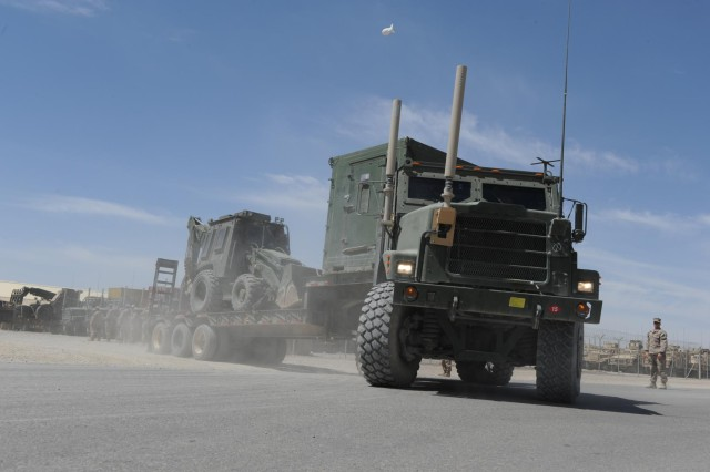 Seabees assigned to Naval Mobile Construction Battalion (NMCB) 15, prepare for a logistical movement mission. NMCB 15 is currently mobilized in support of Operation Enduring Freedom and is an expeditionary element of U.S. Naval Forces that act as combat engineers and support various units worldwide through national force readiness, humanitarian assistance, and building and maintaining infrastructure. (U.S. Navy photo by Mass Communication Specialist 2nd Class Daniel Garas)