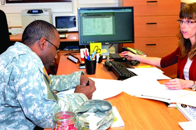 Staff Sgt. Garth Cunningham undergoes an initial ACAP orientation briefing from Wiesbaden ACAP's Angela Roelofs to start the process of separating from the Army.