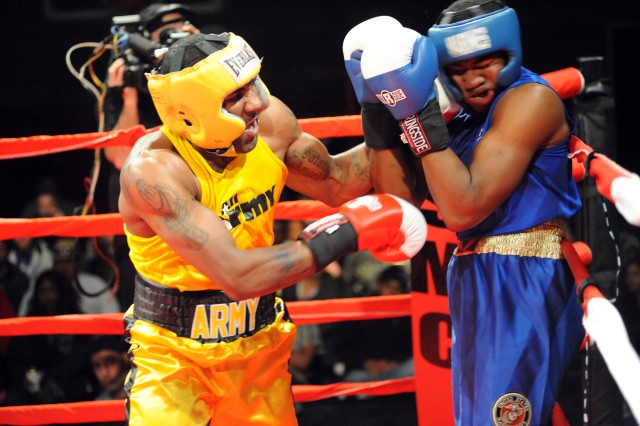 U.S. Army World Class Athlete Program boxer Spc. Steven Nelson, seen here scoring with a left uppercut at the 2013 Armed Forces Boxing Championships at Marine Corps Base Camp Pendleton, Calif., won the light-heavyweight crown at the 2013 National Golden Gloves Championships on May 18 at the Salt Palace Convention Center in Salt Lake City.