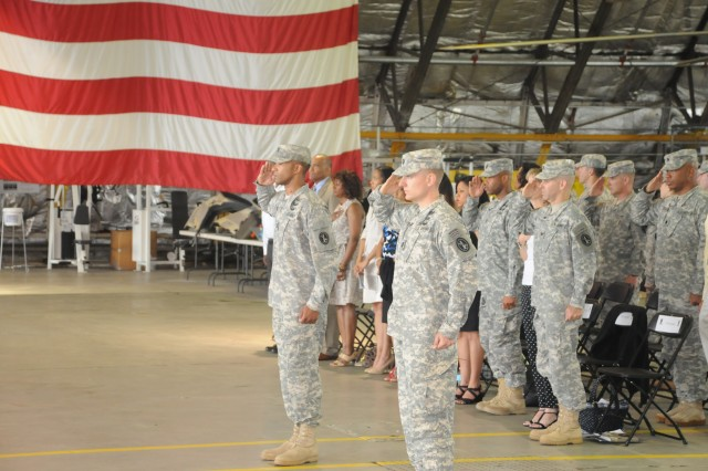 Capt. Michael Riccitiello III (right), the incoming commander of the 911th Technical Rescue Engineer Company stands and salutes next to Capt. Langston J. Turner, the outgoing commander of the unit during a Change of Command ceremony held inside the 12th Aviation Battalion Hangar at Davison Army Air Field, Fort Belvoir, May 23, 2013.