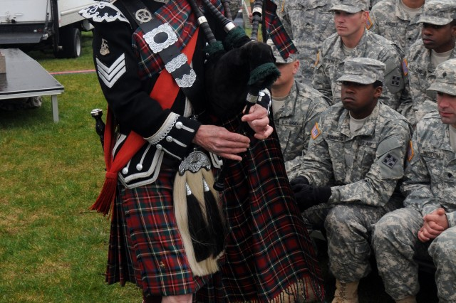 """FORT CARSON, Colo. - John Poss, pipe sergeant, Pikes Peak Highlanders, plays a rendition of """"Amazing Grace,"""" during the Mountain Post Warrior Memorial Ceremony at Kit Carso Park, May 23, 2013. (U.S. Army photo by Spc. Nathan Thome, 4th Inf. Div. PAO)"""