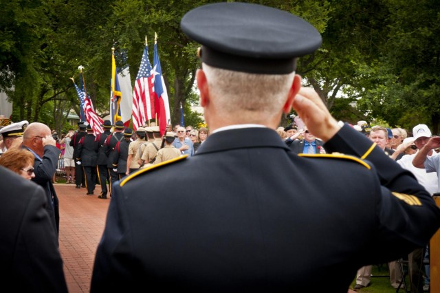 Sgt. Maj. of the Army Raymond F. Chandler III salutes during the retirement of the colors after the Memorial Day ceremony at the Georgetown-Williamson County, Texas, Veterans Memorial Plaza, May 27, 2013.