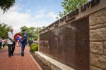 Wreath placed at wall of heroes during Memorial Day ceremony
