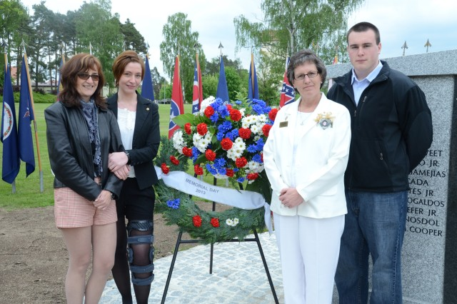 In the wake of Staff Sgt. Derek Farley's death, two families have united to heal. From left to right, Birgit Moebius with her daughter Maria, Derek's girlfriend, pose with Gold Star mom Carrie Farley and Derek's brother, Dylan.