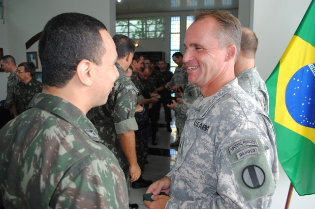 Lt. Col. Chris Eldridge, the Training and Doctrine Command liaison to U.S. Army South, speaks with Brazilian Lt. Col. Marcos Americo, the former Brazilian foreign liaison officer to Army South, following the closing ceremony of the army-to-army staff talks between the U.S. and Brazilian armies May 22 in Manaus, Brazil. (U.S. Army photo by Lt. Col. Robert A. Whetstone, U.S. Army South Public Affairs)