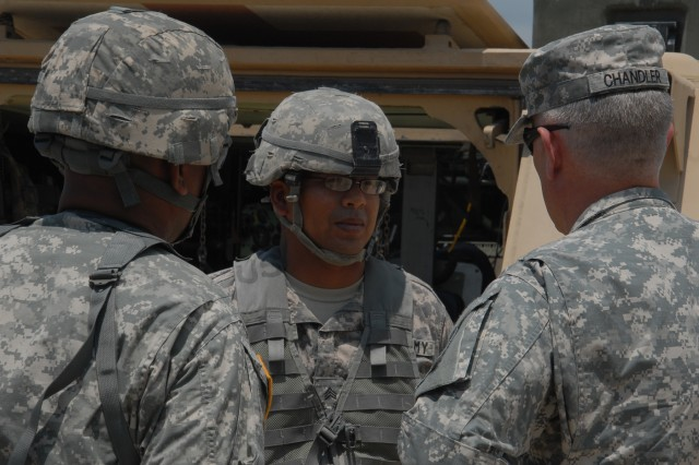 """Sgt. Maj. of the Army Raymond Chandler III (right) speaks with Sgt. Eduardo Cebellos (center), a health care specialist assigned to the 2nd """"Stallion"""" Battalion, 8th Cavalry Regiment, 1st """"Ironhorse"""" Brigade Combat Team, 1st Cavalry Division during a visit May 28, at Fort Hood, Texas. Chandler observed Stallion's training and recognized some Soldiers for their achievements. (Photo by Sgt. John Couffer, 1st BCT, 1st Cav Div Public Affairs)"""