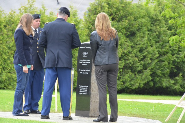 "From left, Emily Brainard, wife of Capt. John ""Jay"" Brainard; Chief Warrant Officer 5 Tom Walton; Col. Jay Voorhees, commander of 12th Combat Aviation Brigade; and Cheyenne Nevada, president of the Ansbach Spouses and Civilians Club, reflect on the memorial May 29 at Katterbach, Germany, dedicated to Capt. Brainard and Chief Warrant Officer 5 John Pratt, two AH-64D Longbow Apache helicopter pilots with 12th Combat Aviation Brigade who were shot down in the Wardak province of Afghanistan during Operation Enduring Freedom May 28, 2012."