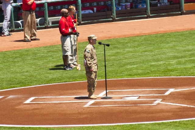 U.S. Navy Culinary Specialist 2nd Class Nicholas Gagner, assigned to Provincial Reconstruction Team Farah, sings the national anthem at the Great American Ball Park as part of the Cincinnati Reds' Memorial Day celebration.