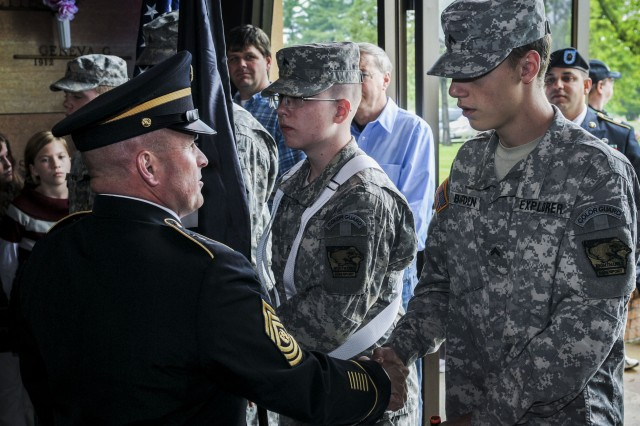 Army Sustainment Command's Command Sgt. Maj. James Spencer speaks to Davenport Military Explorer Color Guard member, Cpl. Bryan Burden, during the City of Davenport Memorial Day Ceremony, in Davenport Memorial Park's chapel in Davenport, Iowa, May 26.  (Photo by Sgt. 1st Class Sean Riley, ASC Public Affairs)