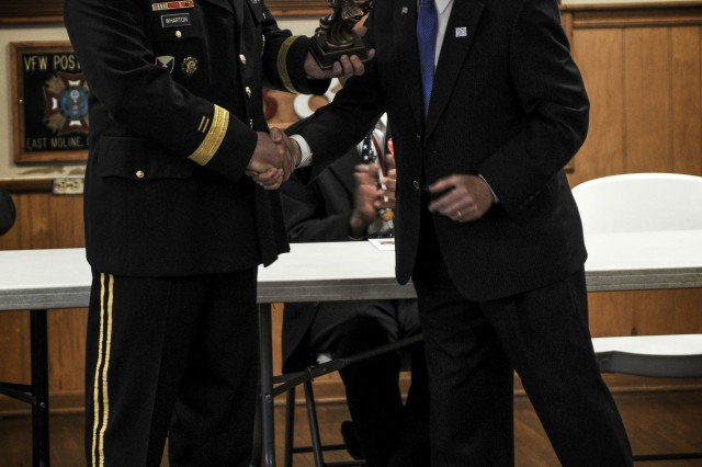 Army Sustainment Command's Commanding General Brig. Gen. John Wharton, accepts a statuette from Mayor Tom Conrad, Silvis, Ill., on behalf of Rock Island Arsenal as part of the City of Silvis' Annual Memorial Day Service at the VFW Post 8890 in East Moline, Ill., on May 25.  (Photo by Sgt. 1st Class Sean Riley, ASC Public Affairs)