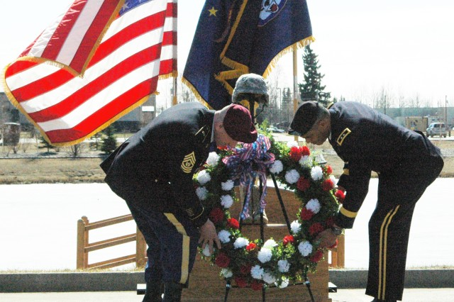 """FORT WAINWRIGHT, Alaska - Maj. Gen. Michael X Garrett (right), commander, United States Army Alaska, and Command Sgt. Major Bernie Knight, command sergeant major, USARAK, set a ceremonial wreath at the base of the Fallen Soldier Memorial May 22 during the Remembrance Ceremony at Monterey Lakes Memorial Park. """"Today is a day to reflect and be mindful, and be thankful to all those who have gone before us, especially those who have made the ultimate sacrifice so we can enjoy the freedom and liberties we have,"""" Garrett said."""