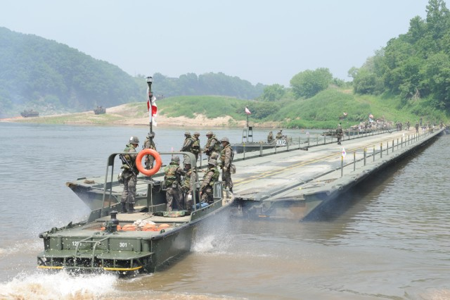 Republic of Korea Army engineers connect a floating bridge across the Imjin River during a combined river crossing training exercise with the 2-9th Infantry, near Yeoncheon, South Korea, May 30, 2013, .