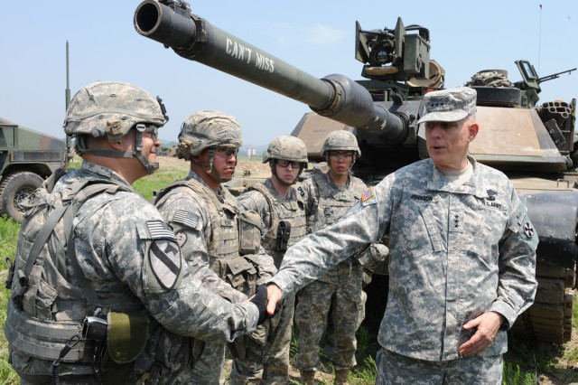 Eighth Army Commanding General Lt. Gen. John D. Johnson (right) thanks 2nd Infantry Division Soldiers during a combined river crossing exercise in Yeoncheon, South Korea, May 30, 2013.