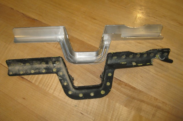 The U.S. Army Research, Development and Engineering Command Field Assistance in Science and Technology-Center, or RFAST-C, reverse engineered and fabricated a Kiowa helicopter's fuselage bracket to return it to flight status. The replacement part is shown above the damaged part.