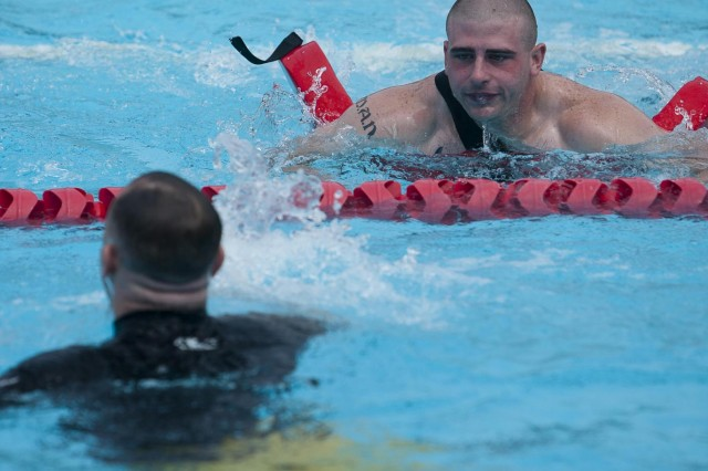 Lance Cpl. Matthew Newton, right, practices rescuing Master Sgt. Jerome Krejcha during a lifeguard class in Major Douglas A. Zembiec Pool May 29, 2013. Marines are taking the lifeguarding course to supplement existing civilian guard positions.