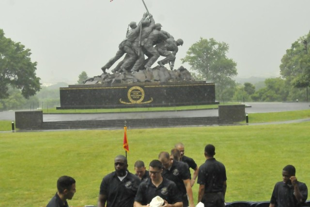"The Marine Barracks ground platoon quits wiping down the rain-soaked VIP seating section following another patch of rain that dumped an inch of rain over a period of an hour and cancelled the Marine Corps' premiere Sunset Parade May 28. The Marines will regroup and return to the Iwo Jima Memorial June 4 for its next Arlington parade. The Marine Corps Silent Drill Team and The United States Marine Drum and Bugle Corps, ""The Commandant's Own,"" are featured at every parade from June through August. June and July parades begin at 7 p.m., while August parades have a 6 p.m. starting time. For more information on the Marine's summer concerts and parades, go to www.barracks.marines.mil and click on parades."