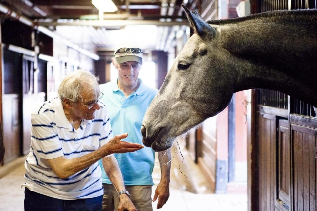 """Anthony sh """"Tony"""" Vernille greets the horse Mickey in the Caisson stables on Joint Base Myer-Henderson Hall May 22, 2013. Vernille was stationed on Fort Myer pre-World War II."""