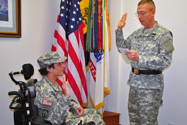 National Training Center and Fort Irwin Commander Brig. Gen. Ted Martin conducts an honorary swearing in for Adam Wolfe, May 28.