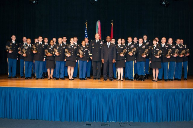 Army Chief of Staff Gen. Ray Odierno and James Wofford from the Douglas MacArthur Foundation pose for a group photo with recipients of the General Douglas MacArthur Leadership Award during its 26th Annual Ceremony May 30 at the Pentagon in Washington, D.C.