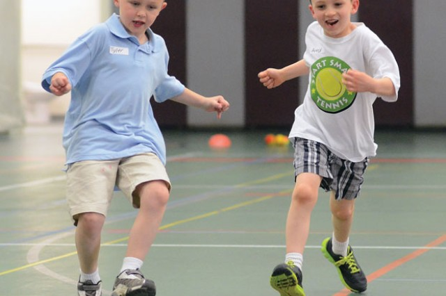 Tyler Cloft, left, and Avery Baltimore, get some warm-up time in before participating in a session of the Child, Youth and School Services Start Smart tennis program May 22 at Specker Field House.