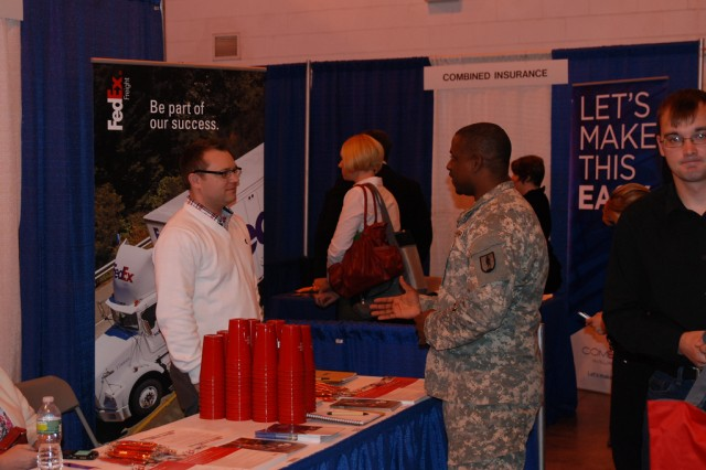 ROCHESTER- A New York Army National Guard Soldiers speaks to a corporate recruiter at the US Chamber of Commerce Hire Our Heroes Job Fair at the New York State Armory in Rochester in April.