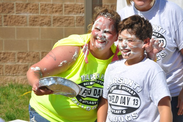 Liz Payne, outgoing president of Barsanti Elementary School's Parent Teacher Organization, pauses for a post-pie fight photo op with 9-year-old Kaden Santos during Barsanti's field day May 29. The PTO donated all proceeds from field day concession sales to relief efforts in Oklahoma City following the devastating tornadoes of May 19. As incentive, faculty members subjected themselves to a pie in the face for each $50 raised.
