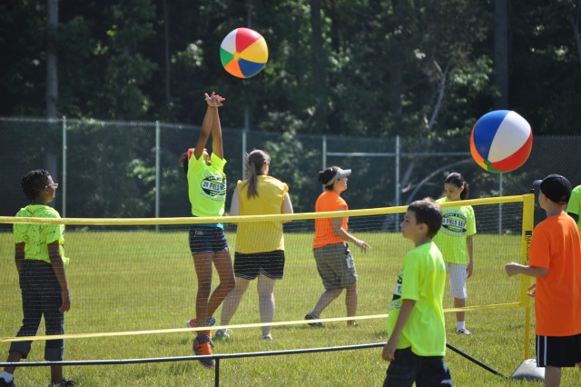 Third, fourth and fifth grade students enjoy beach ball volleyball during their field day at Barsanti Elementary School of Fort Campbell May 29.
