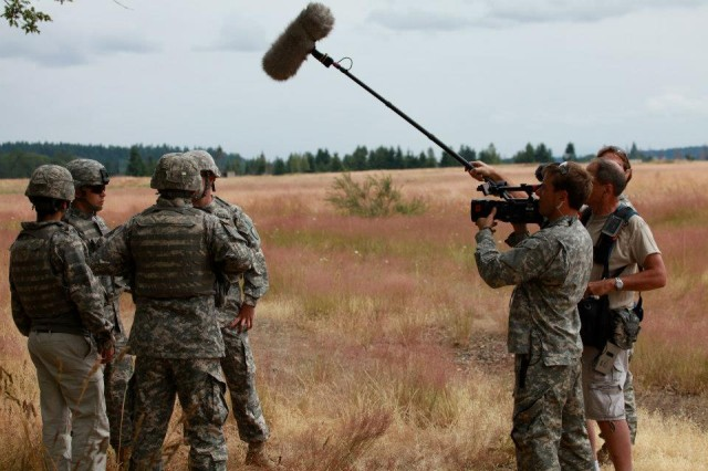 """A camera crew films during the reality-style """"Starting Strong"""" series that features nine potential Army recruits."""