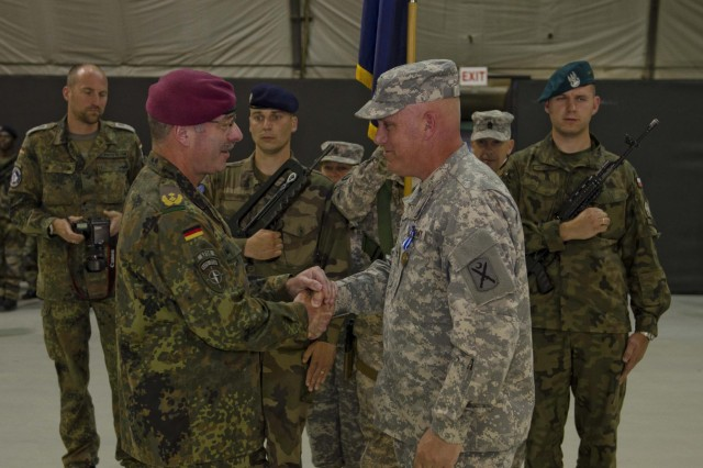 German Army Maj. Gen. Volker Halbauer, the commander of Kosovo Forces, presents U.S. Army Col. Waymon B. Storey III, native of Plum Branch, S.C., commander of the 218th MEB and outgoing commander of Multinational Battle Group-East, with the NATO Medal during the transfer of authority ceremony at Camp Bondsteel, June 1. (U.S. Army Photo by Spc. Samantha Parks, 4th Public Affairs Detachment)
