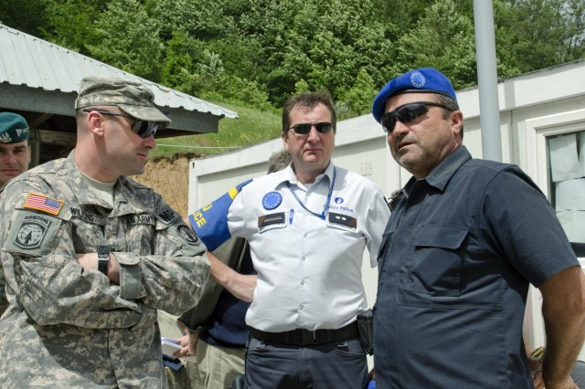 U.S. Army Capt. Anthony Wilkins, a member of the Joint Law Enforcement Liaison Team, speaks with members of the European Union Rule of Law Mission in Kosovo at the new site for Gate 6 outside the city of Gjilan, Kosovo, May 29. Gate 6 sits near the Administrative Boundary Line between Kosovo and Serbia, and serves to help control the freedom of movement for those entering or leaving Kosovo. (Photo by Staff Sgt. Cody Harding, 4th Public Affairs Detachment)