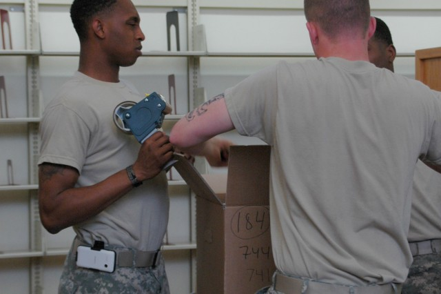 Soldiers from the Vicenza Military Community box up books at the post library for a closure while the library is remodeled. The library will set up temporarily at the BOSS building 9B from June 3-July 12.