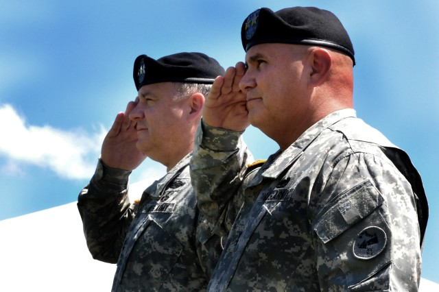 U.S. Army, Pacific Commanding General Francis Wiercinski (on left) and USARPAC Deputy Commanding General, Hawaii National Guard, Maj. Gen. Joseph Chaves, salute the colors at the official retirement ceremony for Chaves May 30 here in historic Palm Circle.