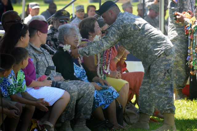A Soldier from the U.S. Army, Pacific presents a lei to Dorothy Varde, mother-in-law of Maj. Gen. Joseph Chaves, USARPAC Deputy Commanding General, during his retirement ceremony. Varde was joined by many other members of the Chaves at the ceremony here May 30 on historic Palm Circle, in honor of Chaves' 43 years of service to the Hawaii Army National Guard.