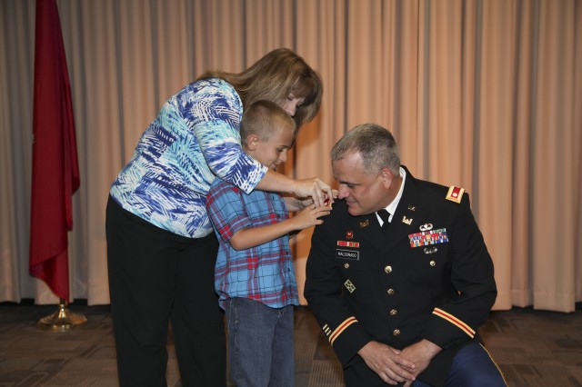 GALVESTON, Texas - U.S. Army Corps of Engineers Galveston District Deputy Commander Maj. Marty Maldonado was promoted to the rank of lieutenant colonel by Commander Col. Christopher W. Sallese June 3, 2013, at a ceremony hosted at the district's headquarters building in Galveston, Texas. Maldonado was joined by his wife and son, who pinned on his new silver oak leaf rank insignia on his uniform.