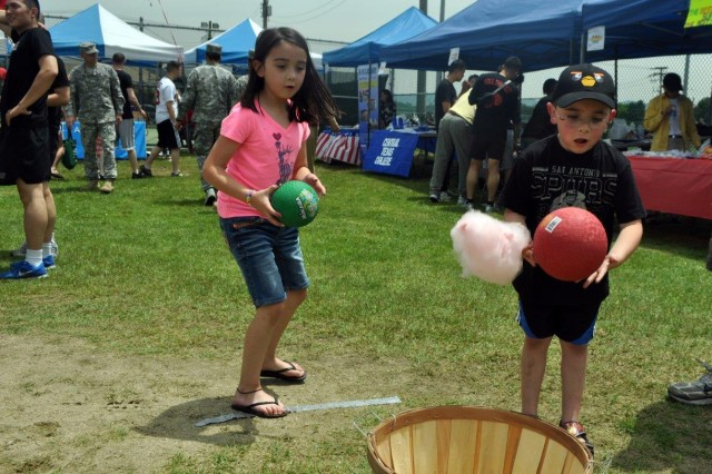 Children play games during the K-16 Summer Festival, May 31. (U.S. Army photo by Cpl. Lim Hong-seo)