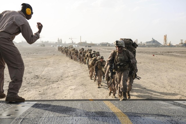 Marines board the landing craft air cushion during the retrograde of Operation Eagle Resolve 2013. Area Support Group - Qatar, as well as other units from Camp As Sayliyah, played a pivitol role during the operation. They assisted U.S. Central Command with logistics and security force support.