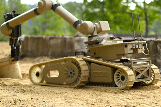 The iRobot Warrior, using a tool on the end of its arm, is able to grab, lift and carry heavy items. The arm can lift up to 350 pounds and the Warrior can carry a payload of up to 150 pounds.