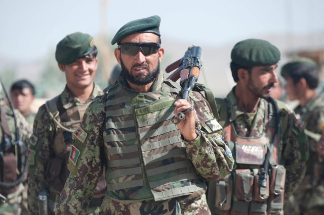 Afghan National Army Maj. Wali Jan, commander of 4th Company, 1st Battalion, 1st Brigade, 203rd Corps, leads his soldiers out of Combat Outpost Baraki Barak on a presence patrol and resupply mission with U.S. Soldiers, in Logar Province, Afghanistan, May 22, 2013. Recent progress in ANA security capacity has enabled the beginning of a shift from coalition-led to Afghan-led security operations.
