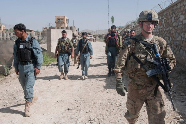 First Lt. Joshua Prior, assigned to Troop C, 6th Squadron, 8th Cavalry Regiment, 4th Brigade Combat Team, 3rd Infantry Division, conducts a presence patrol and resupply mission with Afghan Local Police members and Afghan National Army soldiers, near Combat Outpost Baraki Barak in Logar province, Afghanistan, May 22, 2013.
