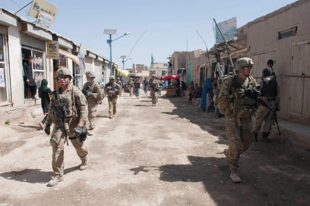 Soldiers assigned to Troop C, 6th Squadron, 8th Cavalry Regiment, 4th Infantry Brigade Combat Team, 3rd Infantry Division, conduct a presence patrol and resupply mission with Afghan National Security Forces through Baraki Rajan, near Combat Outpost Baraki Barak in Logar Province, Afghanistan, May 22, 2013.