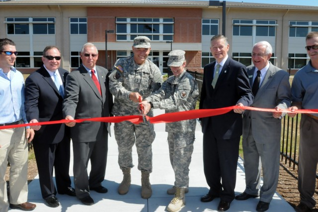 Army Reserve and local officials cut the ribbon during a ceremony for the official opening of a new Army Reserve center in Knightdale, North Carolina on June 1. The new facility will be home to the 518th Sustainment Brigade, 346th Engineering Clearance Company, 1006th Quartermaster Company, 492nd Brigade Signal Company and the 479th Engineering Clearance Platoon.