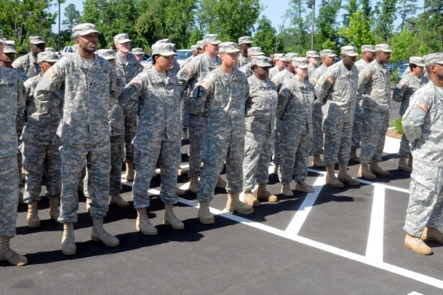 Soldiers of the 518th Sustainment Brigade, stand in formation during the ribbon cutting ceremony for the new Army Reserve center in Knightdale, North Carolina on June 1. The new facility will be home to the 518th Sustainment Brigade, 346th Engineering Clearance Company, 1006th Quartermaster Company, 492nd Brigade Signal Company and the 479th Engineering Clearance Platoon.
