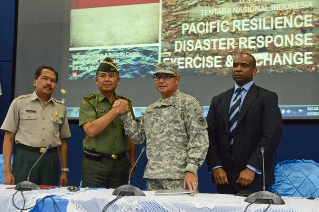Members of the opening panel for the fourth annual Pacific Resilience Exercise and Exchange share a friendly gesture during the opening ceremony held at the International Peace and Security Center in Sentul, Indonesia, June 3, 2013.  Pictured from left to right: Bernardus Wisnu Widjaja, head of Disaster Management Training and Education, Badan Nasional Penanggulangan Bencana, Commodore Meris Widodo, deputy chief of Operations, Mabes Tentara Nasional Indonesia, Maj. Gen. Gary Hara, deputy commander, Hawaii Army National Guard, U.S. Army Pacific and Derrick Brown, U.S. Agency for International Development, U.S. Embassy, Jakarta.