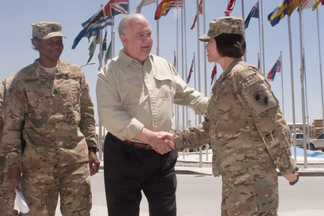 Under Secretary of the Army Joseph W. Westphal congratulates a newly promoted Soldier in Afghanistan, May 30, 2013. Under Secretary of the Army Joseph W. Westphal and Vice Chief of Staff of the Army Gen. John F. Campbell travelled from the Pentagon to observe firsthand the status of ongoing retrograde operations in Afghanistan, gain insight into the readiness of the Afghan National Security Forces, and discuss current issues that impact the health of the force with leaders, Soldiers and the civilian workforce. The pair will take the lessons they learned from each visit with them back to Washington to share with Army senior leaders, better prioritize resources and support mission requirements.